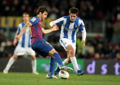 Cesc Fabregas(L) of Real Sociedad vies with Markel Bergara(R) - stock photo