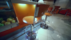 Two chairs stand near bar counter in small cafe-bar Stock Footage