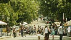 Pedestrians on deribasovskaya street in Odessa, Ukraine in summer time Stock Footage