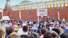 Man makes basketball trick during Dudu Streetbasket fest Stock Footage