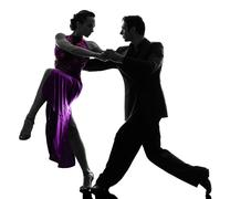 couple man woman ballroom dancers tangoing  silhouette - stock photo