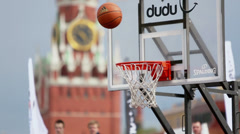 Ball over basket in game during Dudu Streetbasket fest Stock Footage
