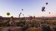 Timelapse of colorful hot air balloons flying over valleys in Goreme, Stock Footage
