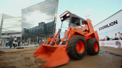 Man in locust loader shows its abilities in dirt Stock Footage