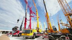 Cranetrucks and caterpillar cranes at Exhibition Stock Footage