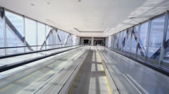 Motion along empty passage tunnel with travelator Stock Footage