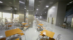 Empty large cafe with many chairs near tables Stock Footage