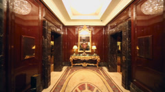 Big vase near mirror in luxurious hall with elevators Stock Footage