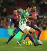 Roque Santa Cruz(R) of Real Betis vies with Adriano Correia(L) - stock photo