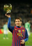 Leo Messi holds up his Golden ball - stock photo