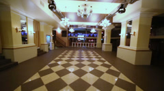 Motion through hall with checkered floor in restaurant Stock Footage