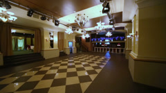 Motion along hall with checkered floor in restaurant Stock Footage