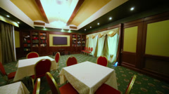 Few empty tables in small private room of restaurant Stock Footage
