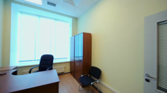 Panorama of small empty cabinet with office furniture Stock Footage