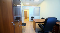 Interior of small empty room with office furniture Stock Footage