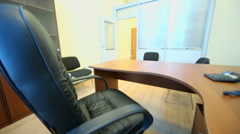 Interior of small empty office room with black armchair Stock Footage