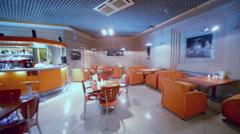 Motion through empty small restaurant in orange tones Stock Footage