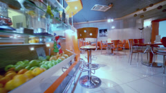 Motion through empty small cafe-bar in orange tones Stock Footage