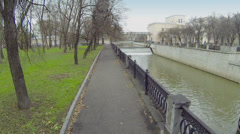 Park near river with sluice of Syromyatnicheskiy waterworks Stock Footage