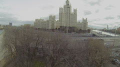 Traffic on embankment near one of seven Stalins skyscrapers Stock Footage