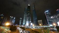 Time lapse urban traffic & skyscraper,night illuminated cityscape skyline. Stock Footage