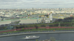 Ship sails down Moskva river and cars ride by road on quay Stock Footage