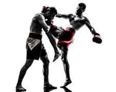 two men exercising thai boxing silhouette - stock photo