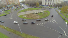 Cars ride by roundabout on Square of Bela Kun Stock Footage