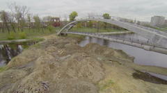 Sand piles near bridge over Cherkizovsky pond in Moscow Stock Footage