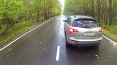 Silvery car stopped on road in forest in Elk Island neighborhood - stock footage