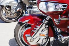 Motor cycle engine and bike reflected in a chromium-plated surface Stock Photos