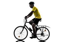 man bicycling  mountain bike silhouette - stock photo