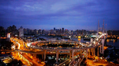 Aerial view of shanghai overpass traffic at night,urban blue skyline,timelapse. - stock footage