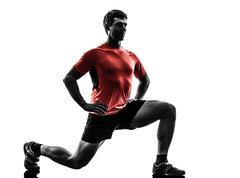 man exercising fitness workout  lunges crouching silhouette - stock photo