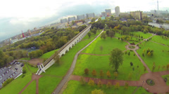 Day view: city panorama with aqueduct near park, aerial view Stock Footage