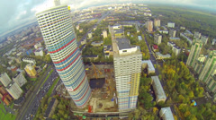 Day view: modern city with colored skyscraper in construction Stock Footage