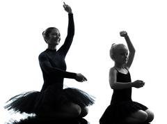 Woman and little girl  ballerina ballet dancer dancing silhouette Stock Photos