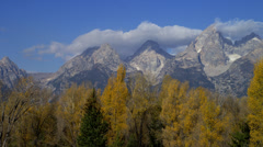 MOUNT TETON AND FALL TREES (PAN) # 2 Stock Footage