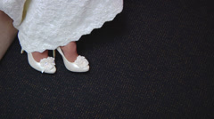 Putting wedding shoes on the bride Stock Footage