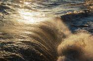 Stock Photo of breaking wave with white spray, full frame