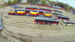Day view: many tramway models parked in depot, aerial view - stock footage