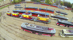 Tram depot plateau with many tram models, above view Stock Footage