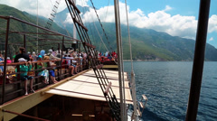 People traveling by ship near Mount Athos Stock Footage