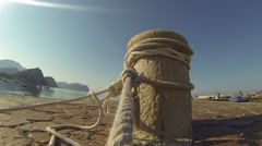 Roaps Tied Around Mooring Bollard Stock Footage