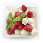 delicious raspberry salad with mozarella and basil - stock photo