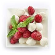 Delicious raspberry salad with mozarella and basil Stock Photos