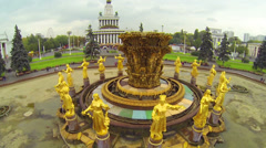 Large fountain with golden statues in square, close up Stock Footage