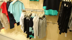 Childrens clothing store with a blue and grey clothes Stock Footage