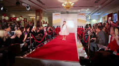 Stock Video Footage of dark hair girl model in white gown at podium