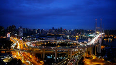 Aerial view of urban overpass traffic at night,city blue skyline. Stock Footage